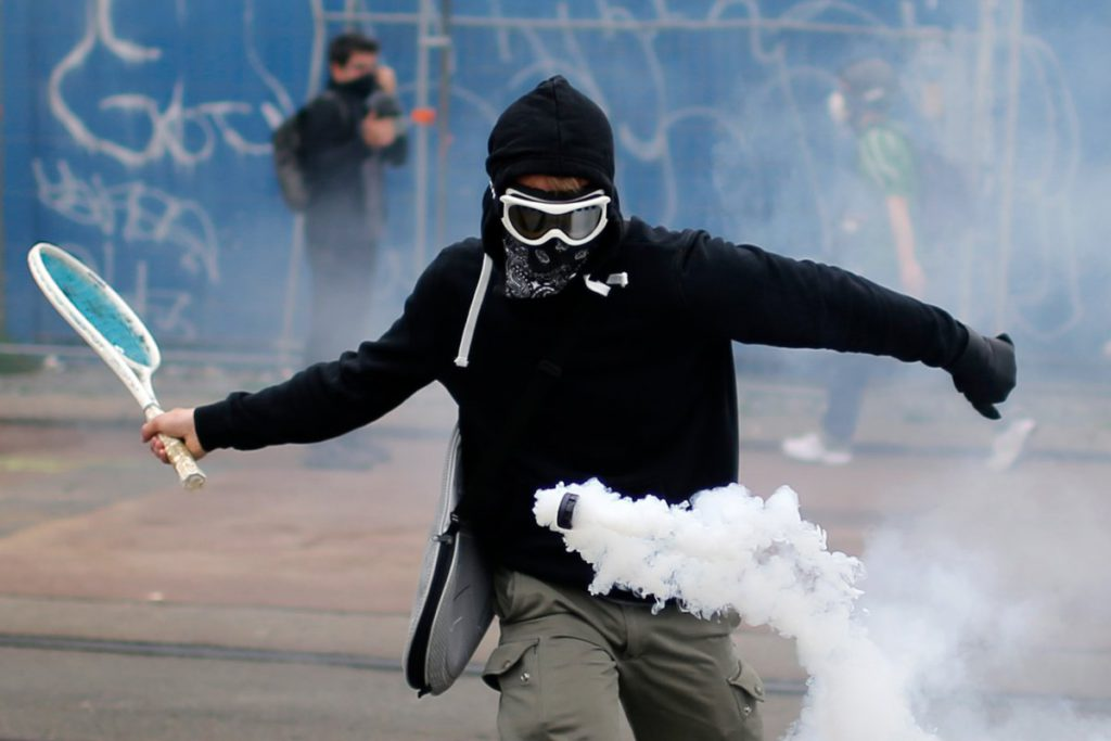 a-protestor-uses-a-tennis-racket-to-bounce-a-tear-gas-canister-during-a-demonstration-to-protest-the-governments-proposed-labor-law-reforms-in-nantes-france-on-june-2